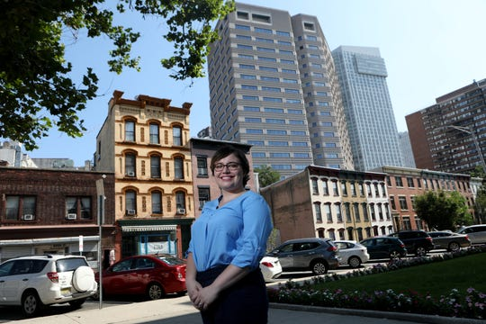 Airbnb Senior Communications Manager, U.S. Northeast, Liz DeBold Fusco, poses for a photographs in downtown Jersey City. Monday, August 19, 2019