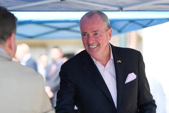 Governor Phil Murphy arrives at a press conference to sign an executive order requiring NJ Transit to share certain metrics such as on-time performance and train cancellations at the Bay Street station on Monday, August 19, 2019, in Montclair.