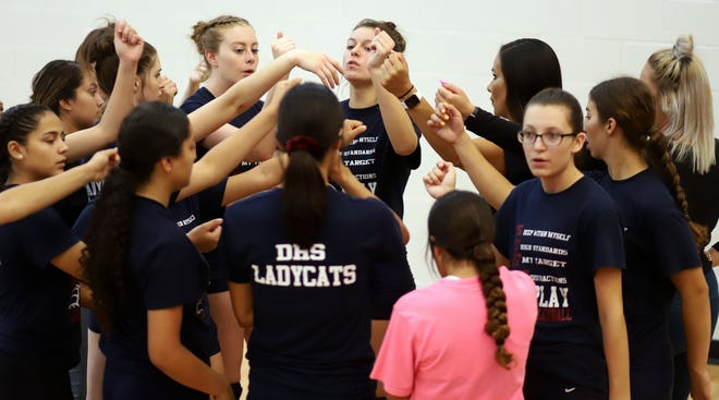 The Deming High Lady Wildcats break from a huddle during a recent scrimmage match at Deming High School.