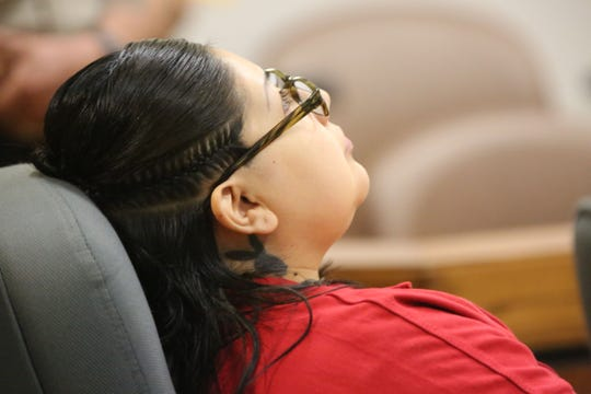 Jocelyn Ontiveros, 31, leans back in her chair in Third Judicial District Court, during a pre-trial detention hearing on Monday, Aug. 19, 2019. She was denied release.