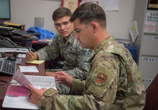 Staff Sgt. Clement Bouloiseau, 49th Wing Safety and Occupational Health specialist, goes through a safety inspection binder with Senior Airman Theodore Warren, 49th Civil Engineer Squadron unit deployment manager, Aug. 14, 2019, on Holloman Air Force Base, N.M. Safety and Health Occupations specialists perform annual facility inspections for various units on base and some Air Force units on Fort Bliss, Texas.