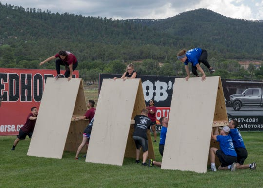 Female competitors jump over a barrier in the obstacle course during Battle of the Bases, Aug. 10, 2019, at the racetrack in Ruidoso, N.M. The Battle of the Bases consisted of six competitions, the final competition determined the winner.