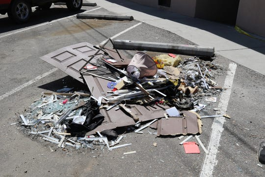 Debris from an explosion at an Aztec apartment were collected in a parking spot  outside the apartment, Monday, Aug. 19, 2019, at 118 W. Chuska St.