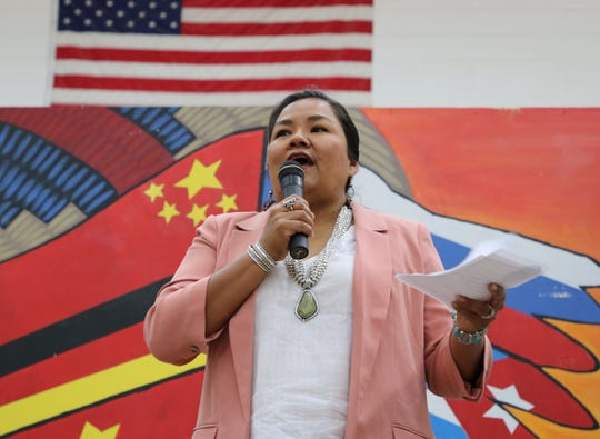 Shawna Becenti, head of school for Navajo Preparatory School, gives the welcome address during the ceremony to recognize five International Baccalaureate Diploma Programme graduates on Aug. 19 at the school in Farmington.