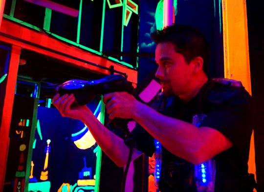 Jake Chasse aims his laser tag gun inside Canton's Zap Zone.