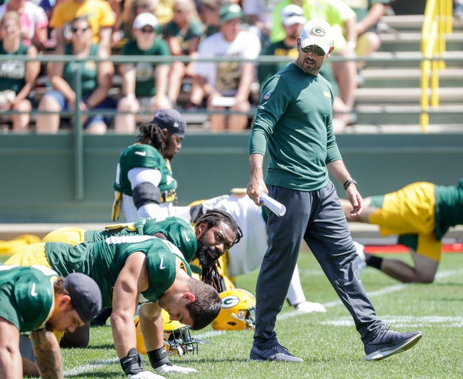 Green Bay Packers' head coach Matt LaFleur talks to players during training camp Monday, August 19, 2019, at Ray Nitschke Field in Ashwaubenon, Wis.