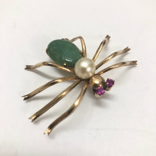 This spider pendant includes a back of glossy jadeite.