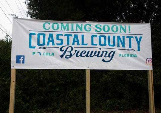 Work on the building for the new Coastal County Brewing Co. is underway Monday. The new brewery is slated to open in December.