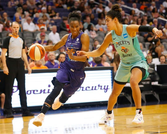 Phoenix Mercury guard Yvonne Turner (6) drives against New York Liberty guard Bria Hartley (14) during the first quarter in Phoenix August 18, 2019.