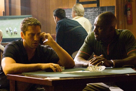 "Gerard Butler (left) and Idris Elba star in ""RocknRolla"" (2008)."