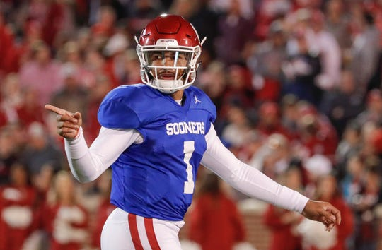 Oklahoma quarterback Jalen Hurts gestures to the sideline during the spring football game on April 12 at Gaylord Family Oklahoma Memorial Stadium.