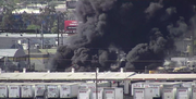 A fire at an industrial lot near 27th Avenue and Palm Lane in Phoenix Monday afternoon.