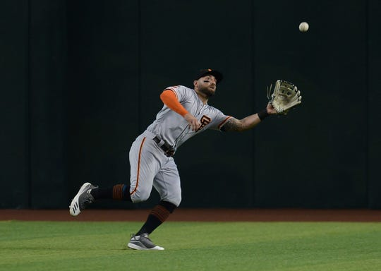 Aug 18, 2019; Phoenix, AZ, USA; San Francisco Giants center fielder Kevin Pillar (1) makes a catch against the Arizona Diamondbacks during the eighth inning at Chase Field. Mandatory Credit: Joe Camporeale-USA TODAY Sports