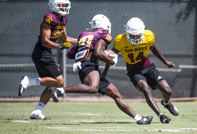 The Arizona State University football team practices in Tempe, Monday, August 19, 2019. Wide receiver Kyle Williams runs after catching the ball.