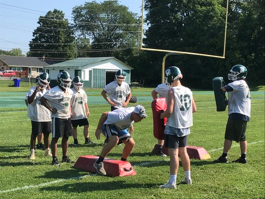 The Spackenkill High School football team practices drills on Monday.