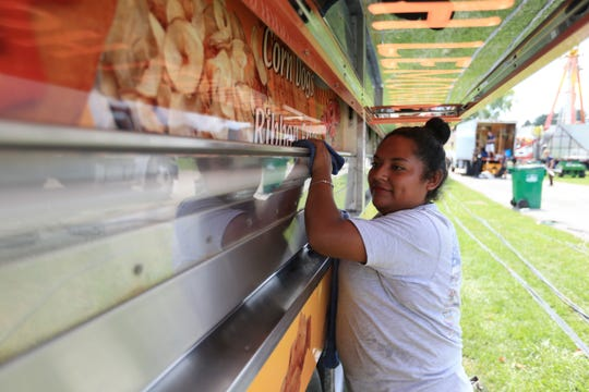 Rosa Mendez of Mexico prepares her food truck for the Dutchess County Fair in Rhinebeck on August 19, 2019.