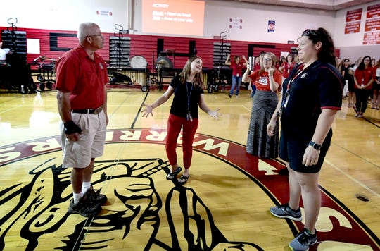 Southern Elementary School teacher Miriam Presley, center, reacts during a community-building morning meeting activity during the district's Opening Day at Susquehannock High School  Monday, Aug. 19, 2019. Southern York County School District staff participated in two in-service days before the start of the school year Wednesday, Aug. 21, when students kindergarten through ninth grade attend class. Grades 10-12 begin Thursday. Bill Kalina photo