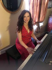 Robin Spielberg sits at the Steinway piano in her New Freedom home.