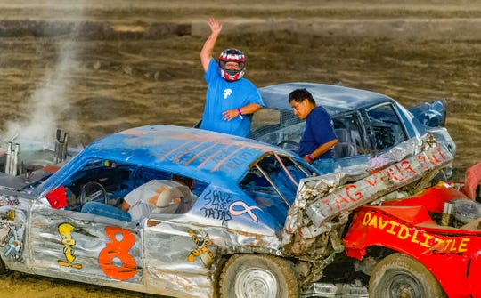 Mitzy Emm waves to the crowd after winning the Destruction Derby's Main Event.