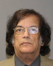 Naeem Butt, 60, owner of Wheels Up Bar/Hotel. Gates police charged him with insurance fraud.
