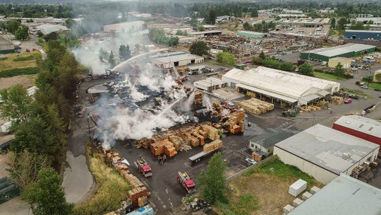 Crews battled a four-alarm blaze in northeast Salem early Monday on Salem Industrial Drive at pallet facility. Fire officials stated the blaze engulfed a large number of wooden pallets but crews had made progress and had the fire spread contained as of 6 a.m.