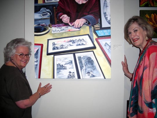 "Artist Shirlene Alexander and Betty Black viewing Alexander's ""Why Use a Brush, Shanghai Street Artist"" at ""Excellence in Art"" at Louisiana State Exhibit Museum."