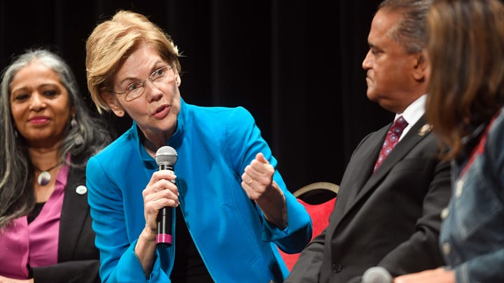 Elizabeth Warren responds to questions from panelists at the Frank LaMere Native American Presidential Forum hosted by Four Directions on Monday, August 19, at the Orpheum in Sioux City.