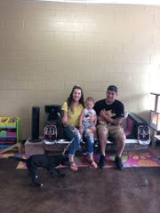 Briana and Austin Tennis adopted Macaroni and Stanley at C.A.R.E. Animal Rescue on Saturday. Stanley, the dog, wanted to get home and wasn't very interested in an adoption photo.