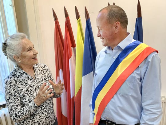 Mayor Vasile Coman visits with a senior member of the Dorries family during their Romanian journey.