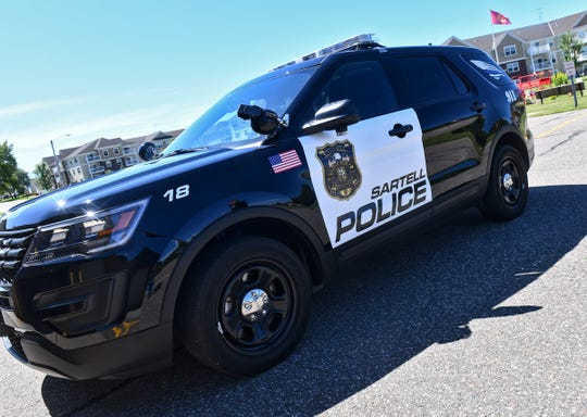 The new, less expensive, graphic design is seen on a Sartell Police Department vehicle Monday, Aug. 19, 2019, in Sartell.