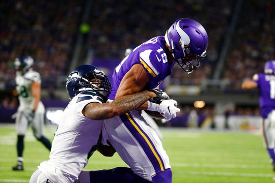 Minnesota Vikings wide receiver Brandon Zylstra catches a 4-yard touchdown pass in front of Seattle Seahawks cornerback Jamar Taylor, left, during the second half of an NFL preseason football game, Sunday, Aug. 18, 2019, in Minneapolis.