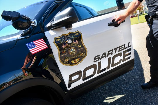A new graphic design is seen on a Sartell Police Department vehicle Monday, Aug. 19, 2019, in Sartell.