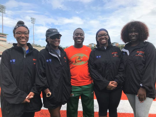 Tia Huie (left), Kimberly McCartney, Kyle Gaines, Tiki Hemingway and Akilah Jackson work together at the FAMU athletic trainers. Gaines is the head trainer and McCartney is his full-time assistant.