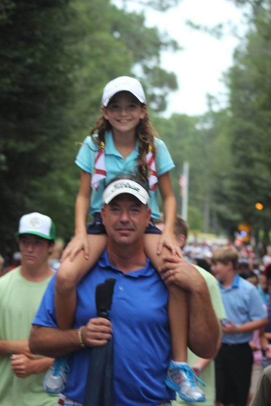 A young Andie Smith sits on the shoulders of her dad, Jeff Smith, at a World Golf Championships event at Pinehurst.