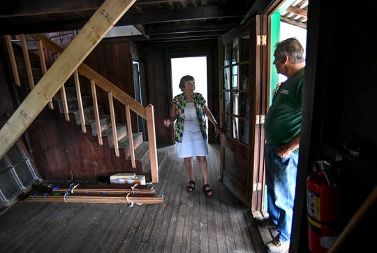 "Marie Stiefel (left), President of the Laura Riding Jackson Foundation, talks with Richard Strouse, a supervisor with Proctor Construction, while looking over the progress made in the reconstruction of the Laura Riding Jackson house on Monday, Aug. 19, 2019, after it was relocated from the Environmental Learning Center to the Indian River State College Mueller campus in Indian River County. ""It's inspiring, it's wonderful to walk in that house and see it starting to take shape,"" Stiefel said. ""Everything's fine, the doors work, the windows work, it's beautiful."""