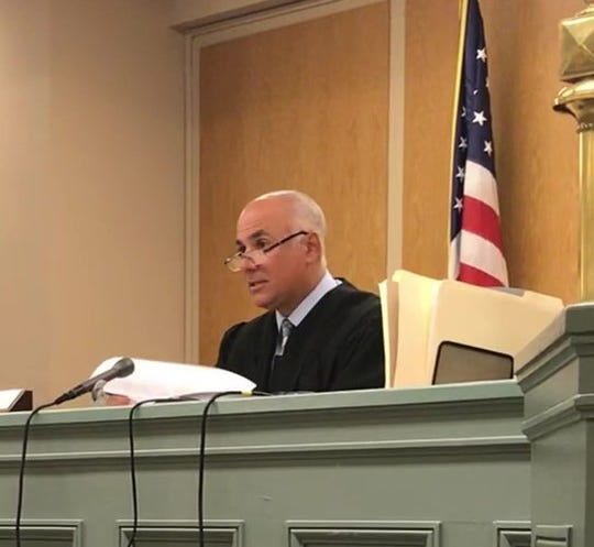 Cumberland County Superior Court Judge Michael Silvanio agreed to postpone until September sentencing in a handgun case against Richard S. Hatcher Jr. of Vineland
