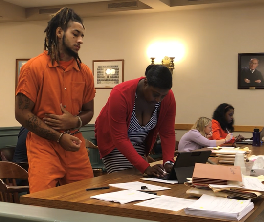 Sentencing in a handgun possession case was delayed on Monday for defendant Richard S. Hatcher Jr., 20, of Vineland. Hatcher (left) is recovering from gunshot wounds that cost him his spleen. Here, he stands with N.J. Deputy Public Defender JoEllyn Jones in Cumberland County Superior Court.