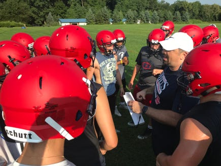Byram Hills football coach Doug Carpenter talks to players during a break on the first day of practice. Aug. 19, 2019.