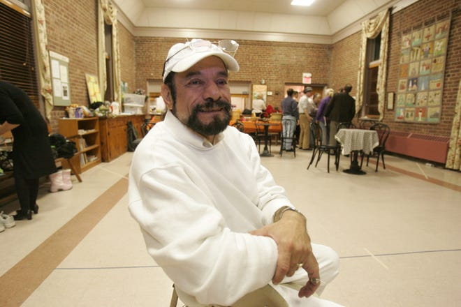 """George Puello, whose career included composer, lyricist, choreographer, director, producer and technical director, during a rehearsal break from a PMT Productions show in 2008. Puello was a spotter of early talent and helped guide the first career steps of Broadway actors John Treacy Egan (""""The Producers"""") and Robi Hager (""""Spring Awakening"""")."""
