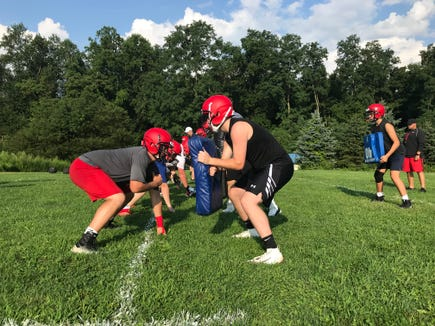 Byram Hills football players run through a drill on the first day of practice. Aug. 19, 2019.