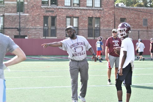 New Ossining head coach Larry McRae, a former Ossining football player and an coach since 1994, directs drill during opening 2019 practice.