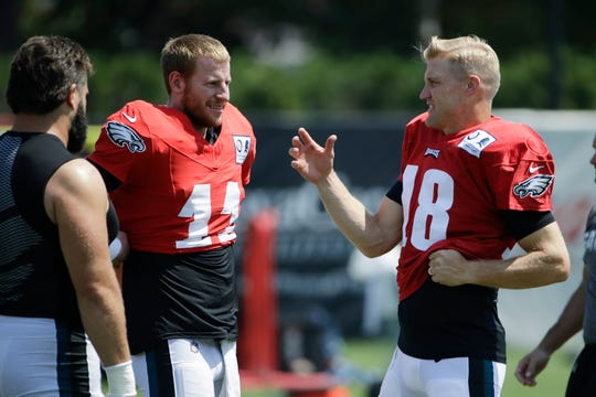 Philadelphia Eagles quarterbacks Carson Wentz (11) and Josh McCown (18) talk during a joint NFL football practice with the Baltimore Ravens in Philadelphia, Monday.