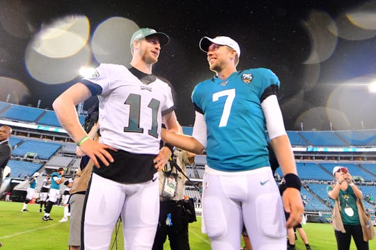 Carson Wentz #11 of the Philadelphia Eagles and Nick Foles #7 of the Jacksonville Jaguars visit with each other after a preseason football game at TIAA Bank Field on August 15 in Jacksonville, Florida.