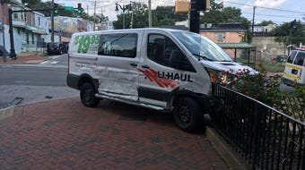 Two juveniles led police on a chase in a stolen U-Haul that ended with a crash, police said. No one was injured and the two are now in custody. Video provided by John J. Jankowski