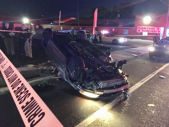 Officials respond to the aftermath of a police chase that ended when the vehicle being pursued crashed into multiple vehicles in Newport.
