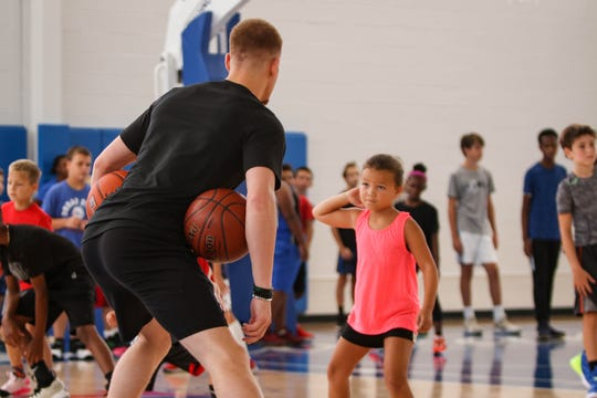 Delaware native Donte DiVincenzo, who now plays pro for the Milwaukee Bucks, helps coach kids at his new basketball camp at the 76ers Fieldhouse on Monday, Aug. 19, 2019.
