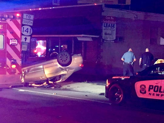 Officials respond to a multi-vehicle crash that closed West Market Street (Del. 4) at Mary Street in Newport.
