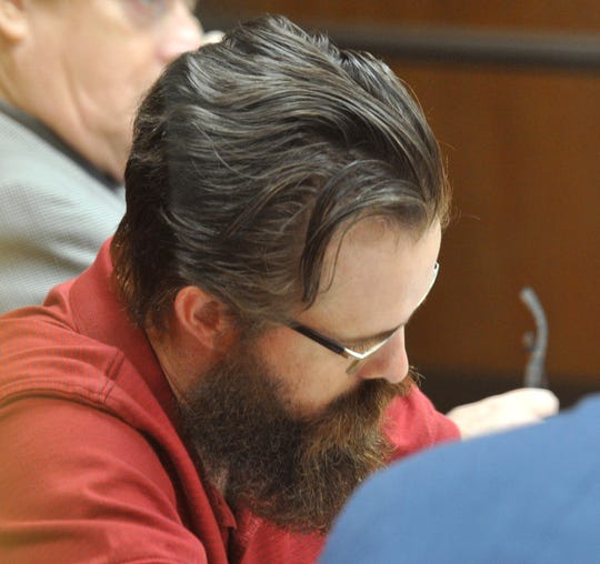 Jonathan Woody listened as Wichita County District Attorney John Gillespie questioned potential jurors, Monday morning, during the jury selection phase of his punishment trial.