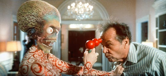"""James Dale (Jack Nicholson) finds himself on the business end of an alien ray gun in Tim Burton's """"Mars Attacks!"""""""