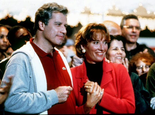 """John Travolta stars with Emma Thompson as a Clinton-esque contender vying for the presidency in """"Primary Colors."""""""